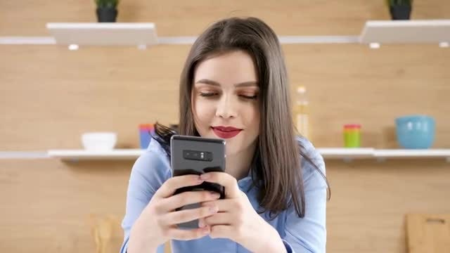 Woman Chatting On Her Smartphone: Stock Video