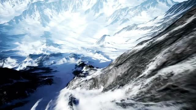 Beautiful Aerial Flight Over Snowy Mountain: Stock Motion Graphics