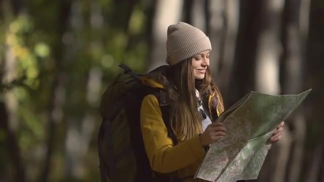 Camper Girl Using Map : Stock Video