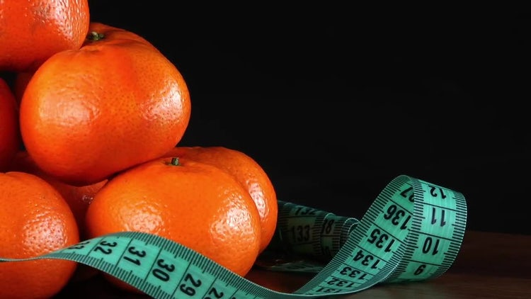 Mandarin Oranges With Measurement Tape: Stock Video
