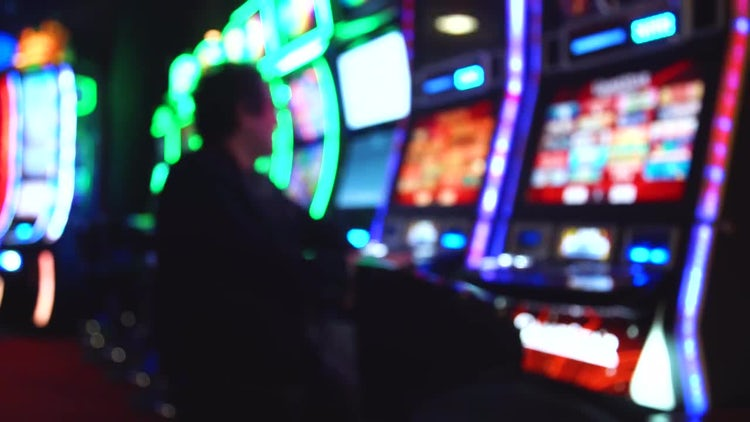 Guy Playing A Slot Machine : Stock Video
