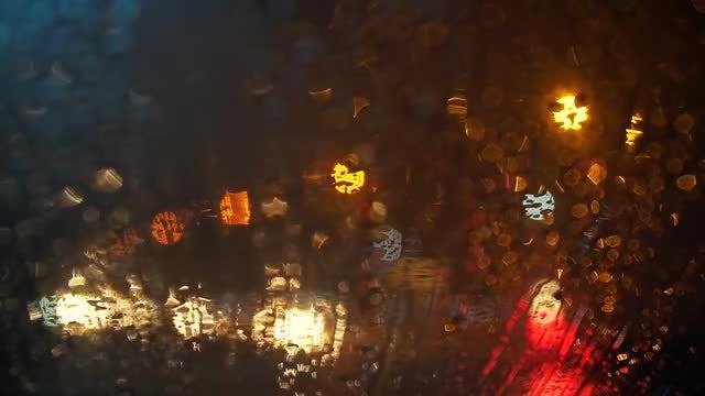 Rainy Traffic Bokeh: Stock Video