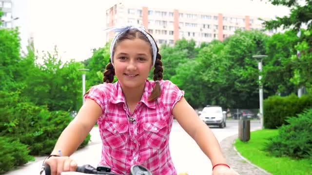 Teenage Girl Riding Bicycle: Stock Video