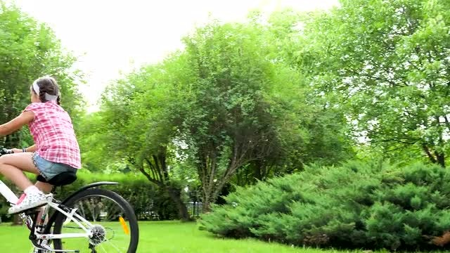 Teenage Girl Riding Bicycle : Stock Video