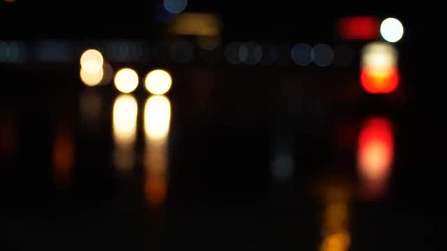 City Traffic Bokeh At Night: Stock Video