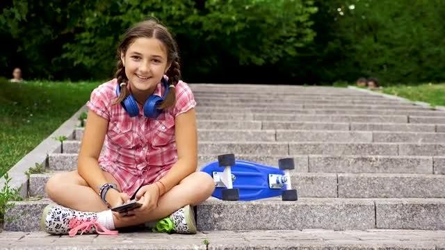 Girl Takes Selfie In Park : Stock Video
