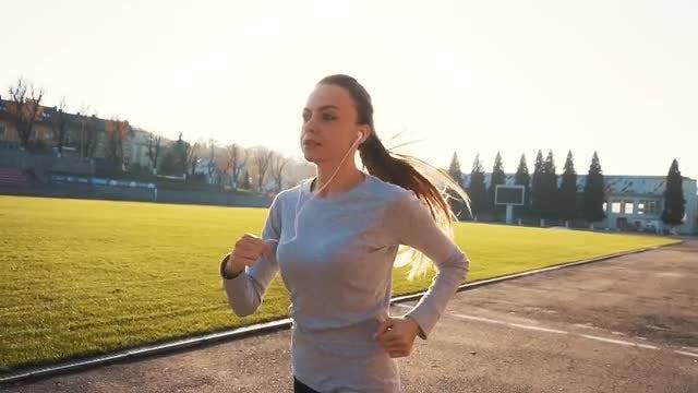 Woman Running At Stadium: Stock Video