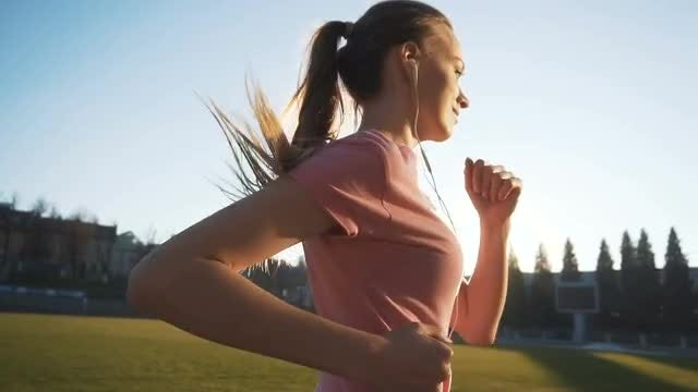 Sportsgirl Running Against Sunset: Stock Video