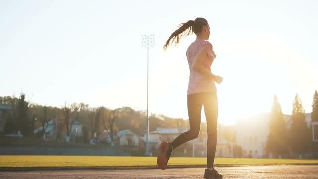 Jogger Running By Camera : Stock Video