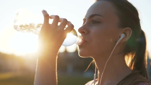 Sportswoman Drinking Water: Stock Video
