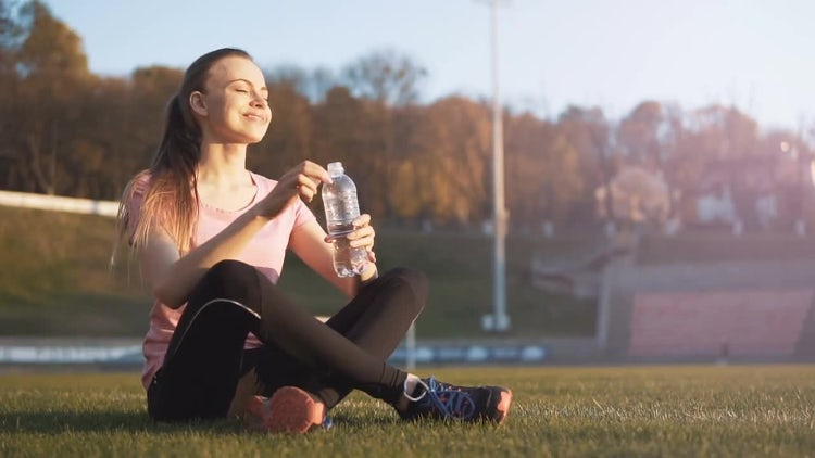 Girl Drinking Water In Stadium: Stock Video