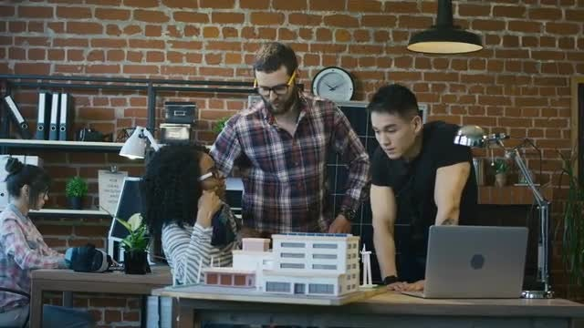 Architects Discuss Building Model: Stock Video