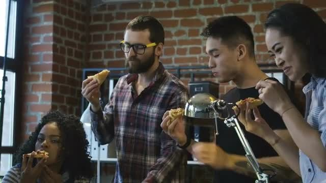Colleagues Eating Pizza Together: Stock Video