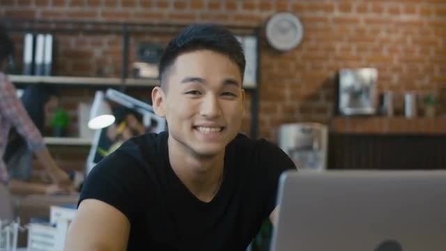 Young Man Using A Laptop: Stock Video