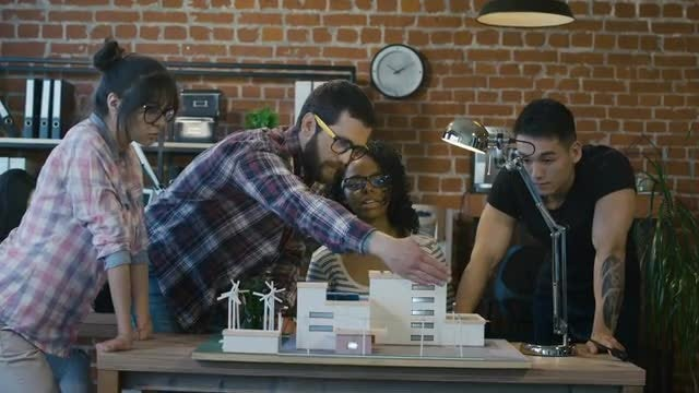 Young Architects Discussing Solar Project: Stock Video