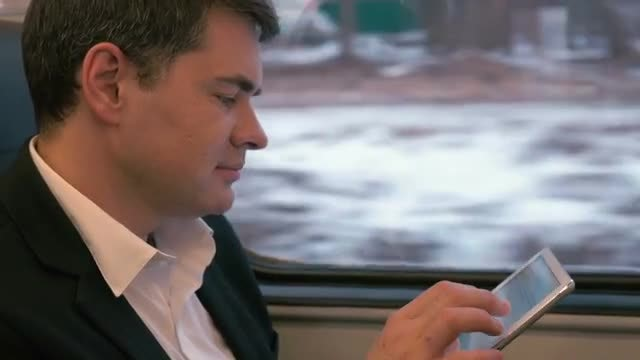 Businessman Using Tablet On Train: Stock Video