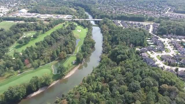 Aerial View of River And Neighborhood: Stock Video
