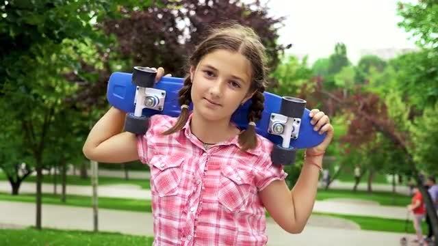 Teenage Girl Carrying A Skateboard : Stock Video