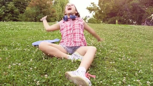 Young Girl Playing With Grass: Stock Video