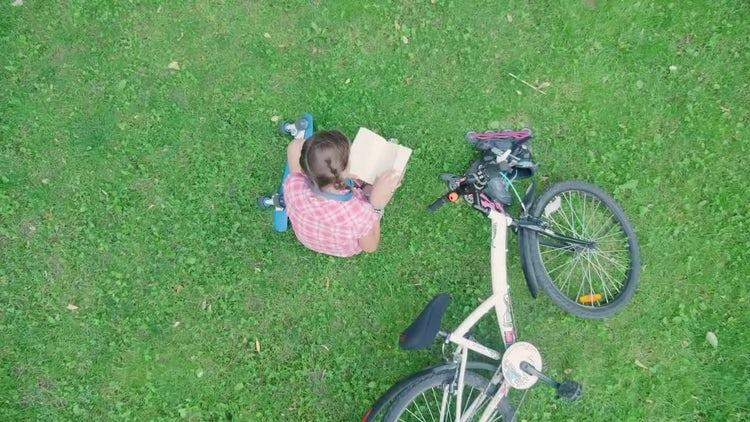 Girl Reading Book In Park : Stock Video