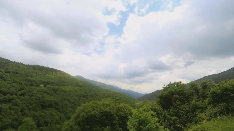 Timelapse Over A Green Valley: Stock Video