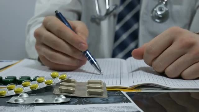 Doctor Writing Medical Notes: Stock Video