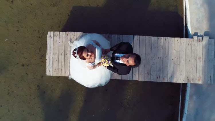 Bride And Groom Rotating Aerial: Stock Video