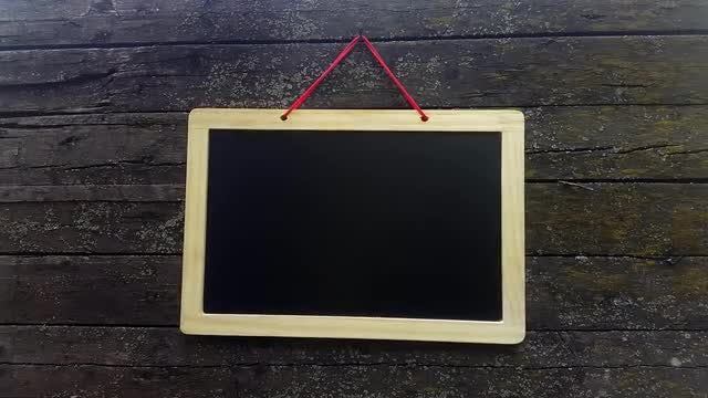 Hanging A Chalkboard On An Old Wall: Stock Video