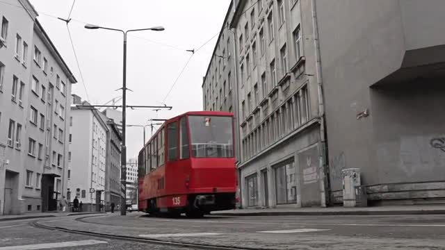 Red Tram In The Black And White City: Stock Video