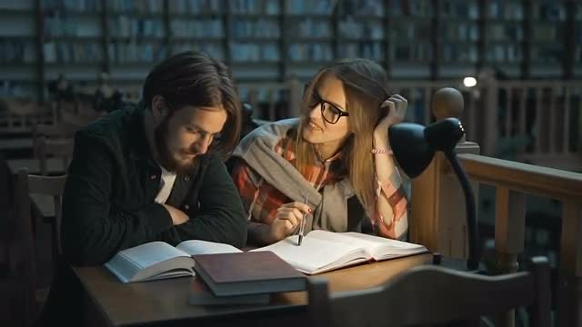 Studying Together In Library: Stock Video