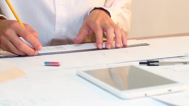 Engineer Uses Ruler And Pencil: Stock Video