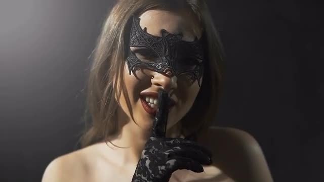Masked Girl Making Silence Sign: Stock Video
