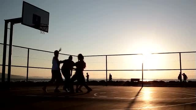 Silhouettes Of Men Playing Basketball: Stock Video