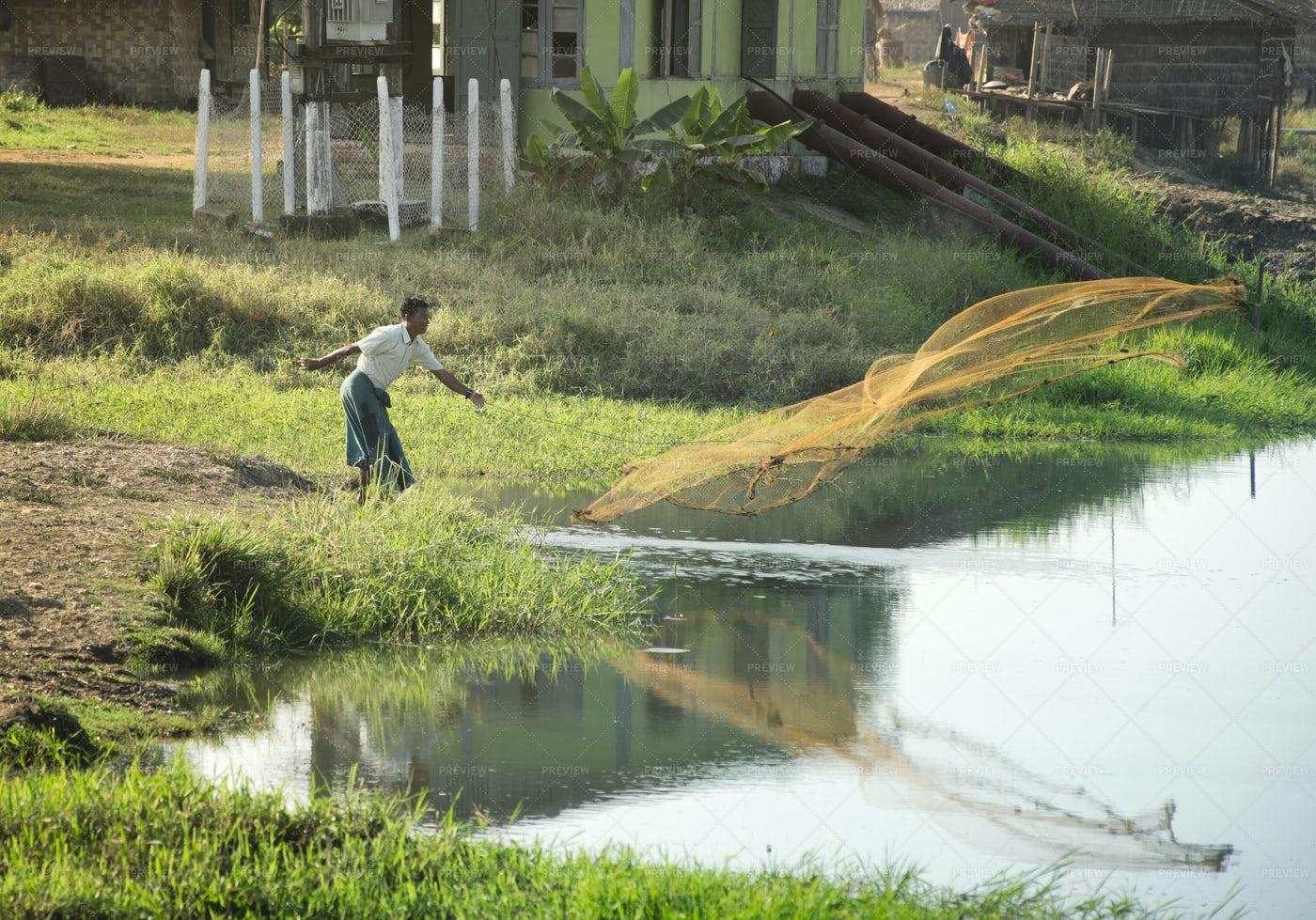 Fisherman Throwing A Fishing Net: Stock Photos