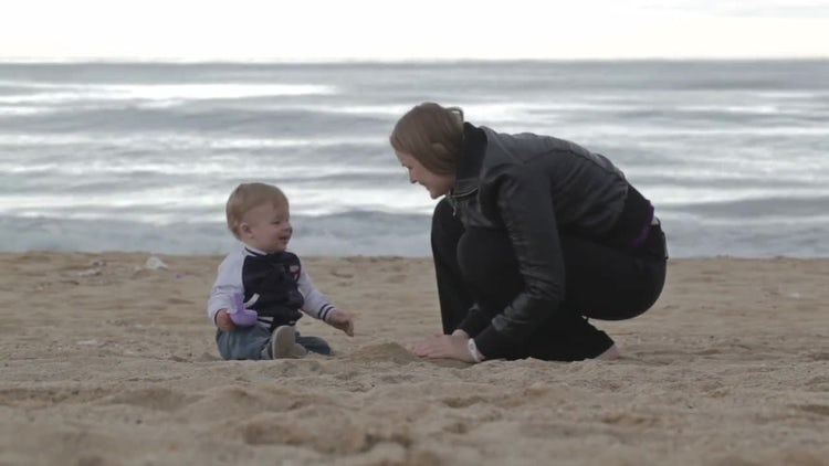 Mother And Son On Beach: Stock Video