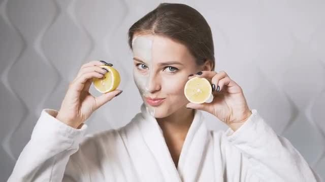 Happy Woman Showing Lemon: Stock Video