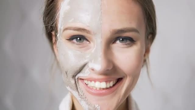 Woman With Peel-off Mask: Stock Video