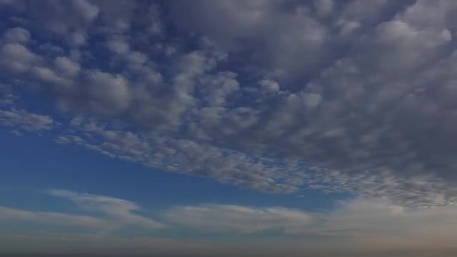 Strato-Cumulus Clouds Near Sunset: Stock Video