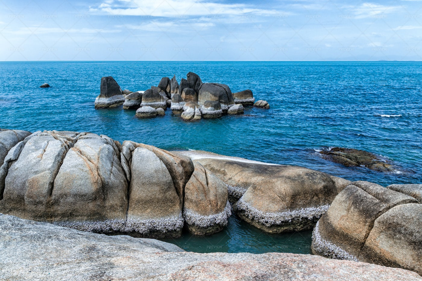 Stones In Blue Sea Water: Stock Photos