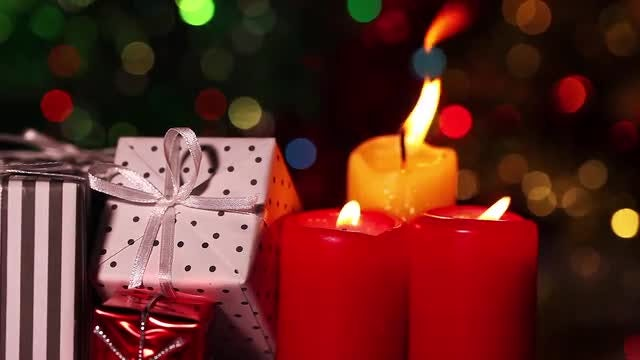 Gift Boxes And Colored Candles: Stock Video