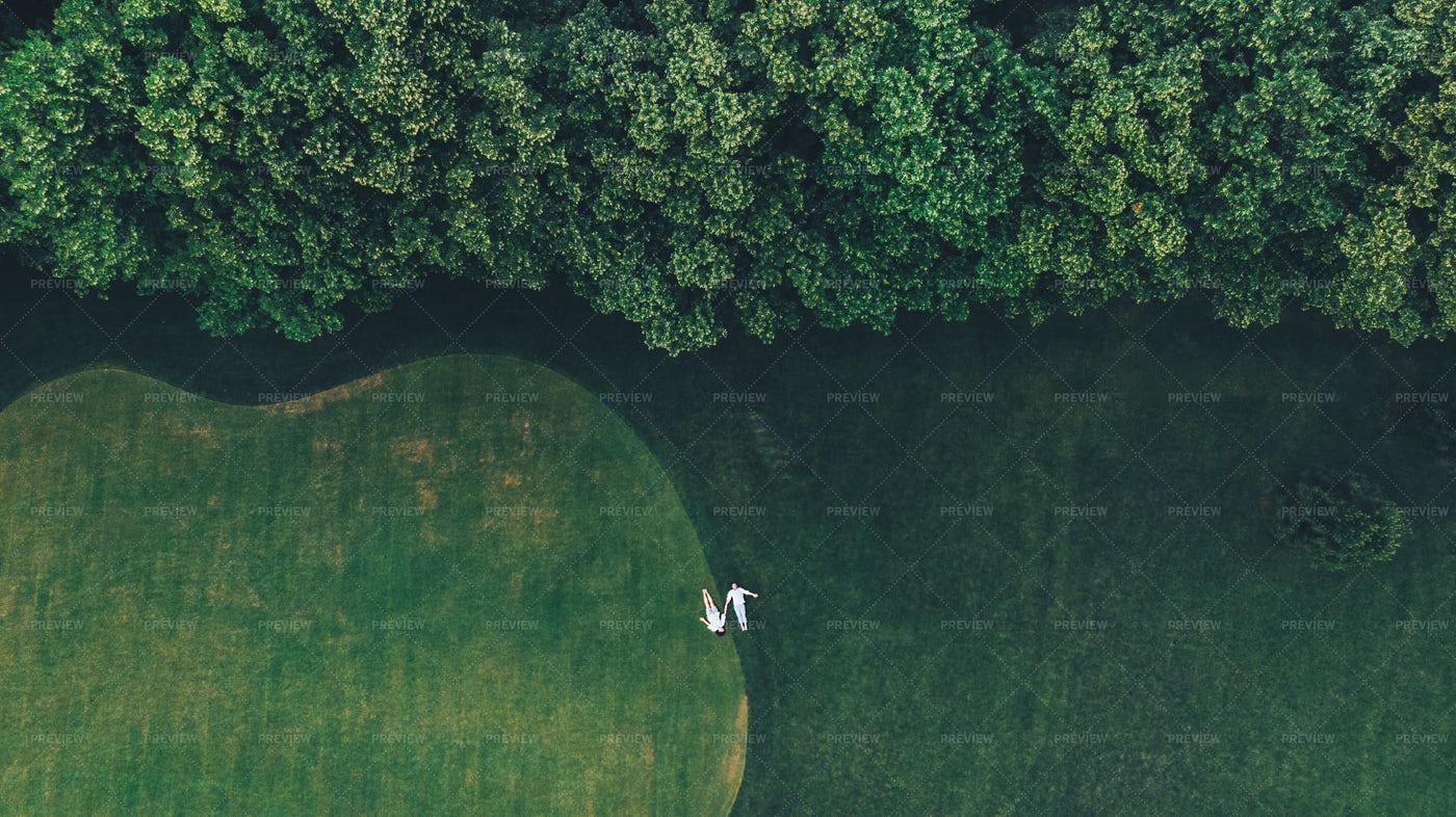 Couple Is Lying On A Golf Course: Stock Photos