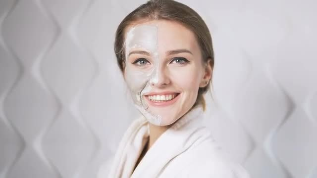 Beautiful Girl With Peel-off Mask: Stock Video