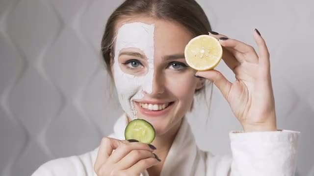 Girl Displaying Cucumber And Lemon: Stock Video