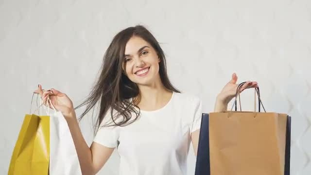 Happy Girl With Shopping Bags: Stock Video