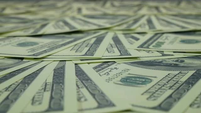 Panning Shot Of Dollar Bills: Stock Video