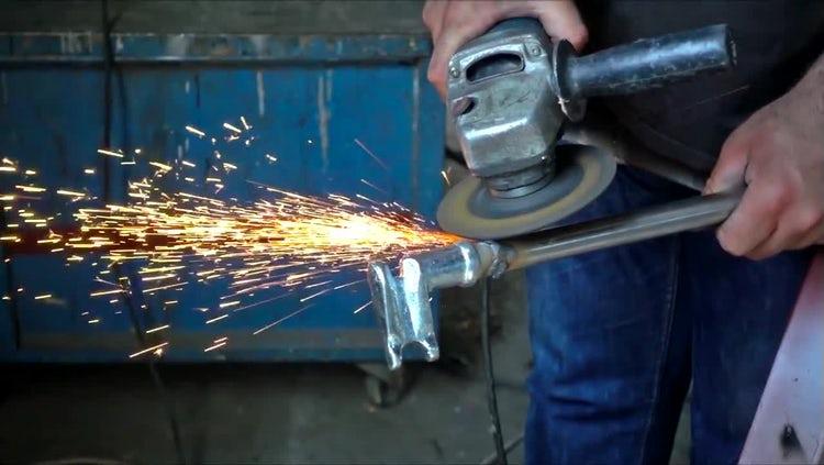 Man Handling Metal Grinding Machine: Stock Video