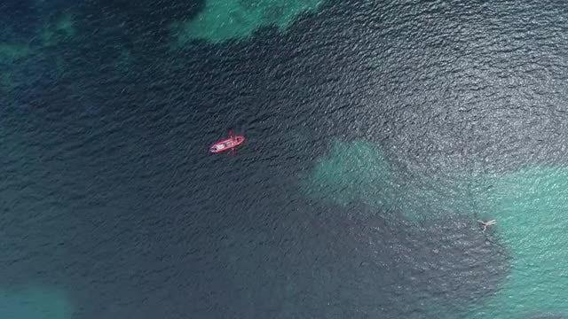 Aerial Shot Of Lone Kayak: Stock Video