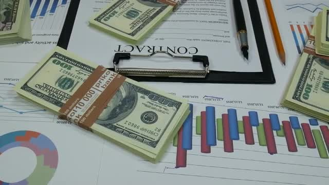 Business Contract And Dollar Bills : Stock Video