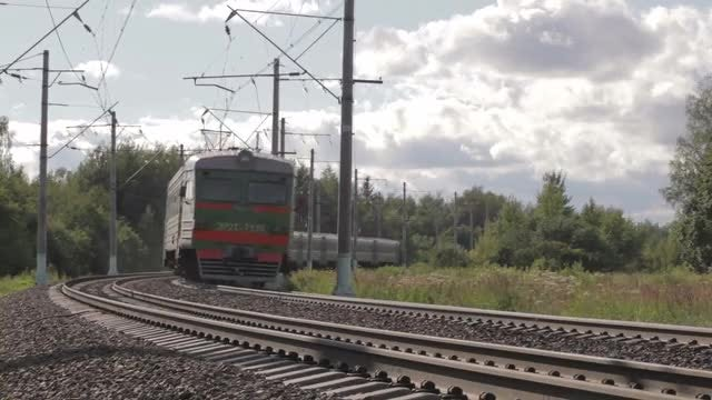 Passenger Train Disappearing Into Forest: Stock Video