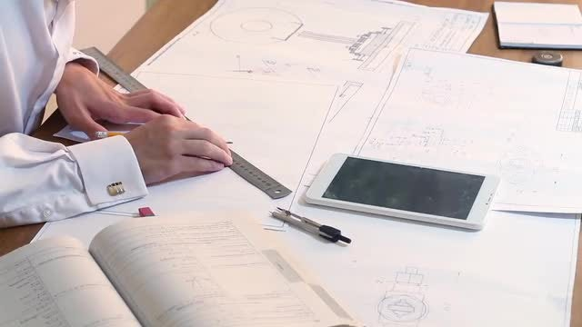 Architect Draws A Plan : Stock Video